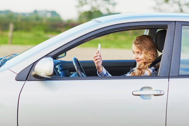 The New York Department of Motor Vehicles is warning drivers of the dangers associated with taking selfies behind the wheel. Photo by Ekaterina Pokrovsky/Shutterstock.cm