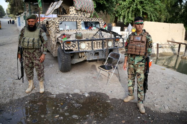Afghan security officials secure a checkpoint in Bahsood district of Nangarhar province, Afghanistan on August 6, 2018. Security in various districts of Nangarhar has been intensified after a recent wave of bomb blasts in different parts of the country. Photo by Ghulamullah Habibi/EPA-EFE