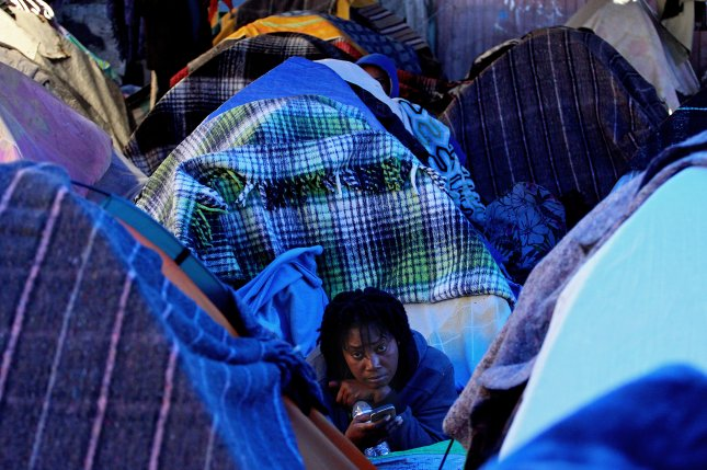 A Haitian migrant looks from a tent in a refugee shelter in Tijuana, Mexico, on January 16. Tijuana has become a shelter for Haitians who fled their country since the 2010 earthquake and tried to cross into the United States. Here, they find themselves stranded as U.S. authorities have increased deportations to Haiti since end of 2016. Photo by Alejandro Zepeda/EPA