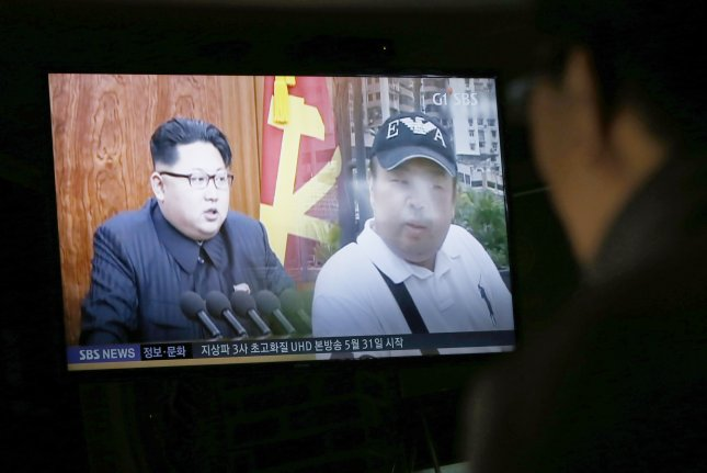 A South Korean watches TV showing news about the alleged assassination of North Korean leader Kim Jong Un's half-brother at a restaurant in Pyeongchang, Gangwon-do, South Korea. The older Kim's murder was cited as an example of North Korea human rights violations at the United Nations Human Rights Council in Geneva on Friday. Photo by Jeon Heon-Kyun/EPA