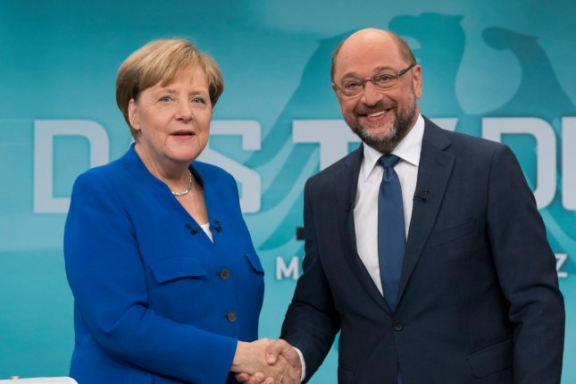 German Chancellor Angela Merkel and Social Democrat Party leader Martin Schulz reached an agreement Wednesday for a new coalition contract. File Photo by Herby Sachs Wdr/ EPA-EFE