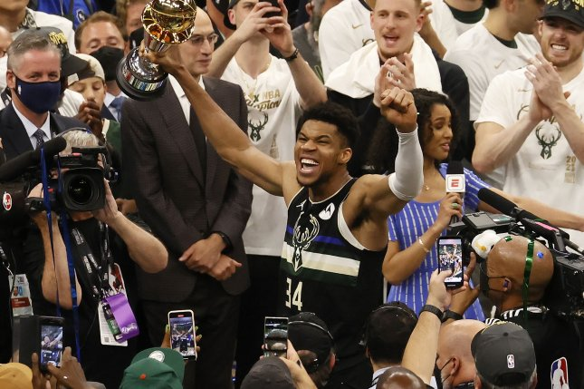 Milwaukee Bucks forward Giannis Antetokounmpo celebrates on Tuesday night with the MVP trophy at the conclusion of Game 6 of the 2021 NBA Finals, at the Fiserv Forum in Milwaukee, Wis. Photo by Tannen Maury/EPA-EFE