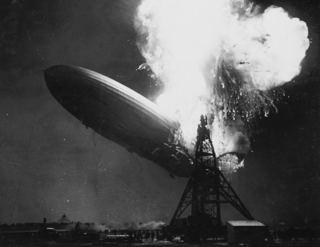 The largest manmade object ever to fly, the 800-foot airship Hindenburg erupts in a fireball at Lakehurst, N.J., on its arrival from Europe on May 6, 1937. Static electricity ignited the airship's flammable fabric skin, and 37 seconds later the airship crashed to the ground, killing 35 of its 97 passengers and crew. This spectacle ended the era of the passenger airship. Photo by Sam Shere/INS/UPI