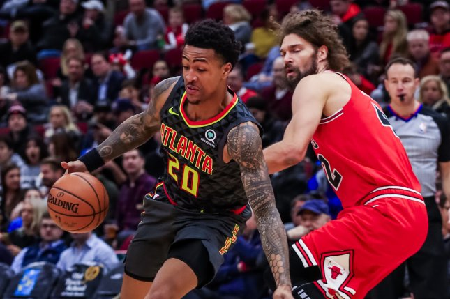 Atlanta Hawks forward John Collins (L) tested positive for growth-hormone releasing Peptide-2 (GHRP-2). File Photo by Tannen Maury/EPA-EFE