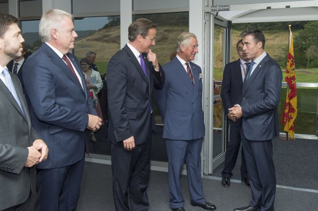 NATO Secretary General Anders Fogh Rasmussen meets with Charles, the Prince of Wales at the Wales NATO summit on September 4, 2014. (NATO/UPI)