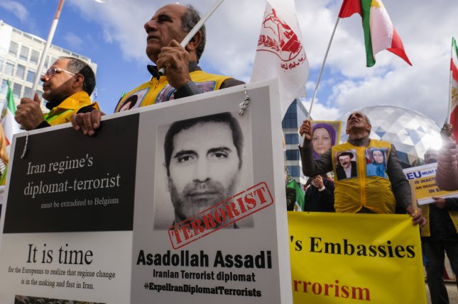 Iranian opposition activists, members of the National council of Resistance of Iran, protest with portrait depicting Iranian official Assadollah Assadi, in Brussels, Belgium, in 2018. He is now on trial in Belgium on terrorism charges. File Photo by Olivier Hoslet/EPA-EFE