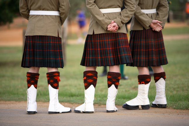 The Hootananny pub in Inverness announced its male servers will no longer be wearing kilts, similar to these worn by military officers, after harassment from female customers. Photo by Mark Atkins/Shutterstock