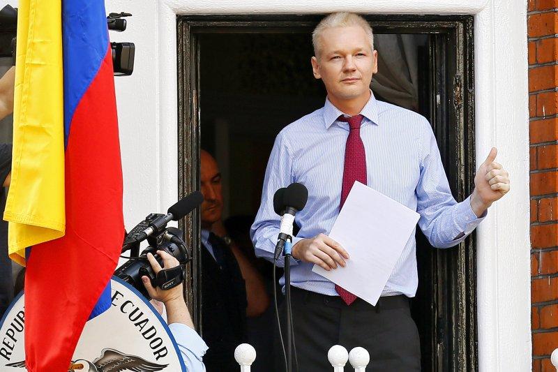 Wikileaks founder Julian Assange speaks on the balcony of the Ecuadorian Embassy in London, where he's lived since 2012. File Photo by Kerim Okten/EPA