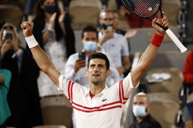 Novak Djokovic of Serbia celebrates after beating Rafael Nadal of Spain in the French Open men's semifinal Friday at Roland Garros in Paris. Photo by Yoan Valat/EPA-EFE