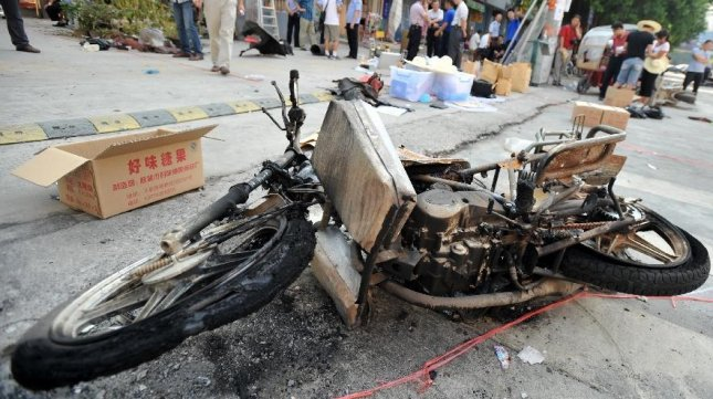 Photo taken on Sept. 9, 2013 shows a destroyed motorcycle at the accident site near Balijie Primary School in downtown Guilin, south China's Guangxi Zhuang Autonomous Region. At least two people were killed and at least 44 injured in an explosion happening on Monday morning in Guilin. A three-wheeled motorcycle passing by the school caught fire and exploded with a huge sound, according to witnesses. (Xinhua/Lu Bo'an)