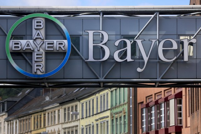 A Bayer logo appears on the facade of a pedestrian bridge in front of the factory of Bayer AG in Wuppertal, Germany. With the merger of Bayer and Monsanto Co., the Monsanto name will be retired. File Photo by Oliver Berg/EPA