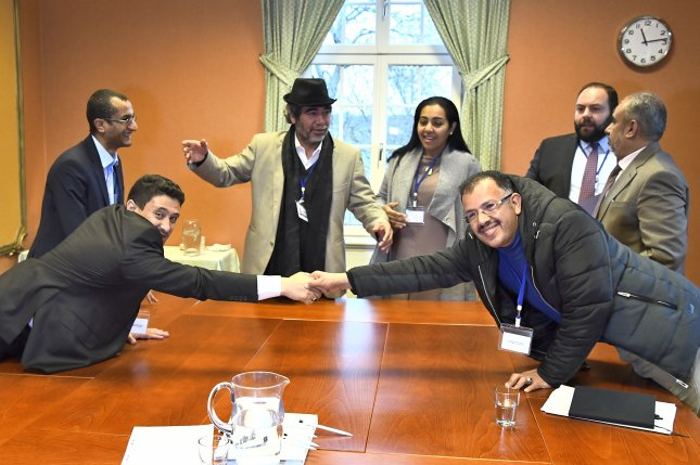 Negotiators for Yemen's government and Houthi rebels shook hands Tuesday after agreeing to terms on a large-scale prisoner swap during peace talks in Sweden. Photo by Claudio Bresciani/EPA
