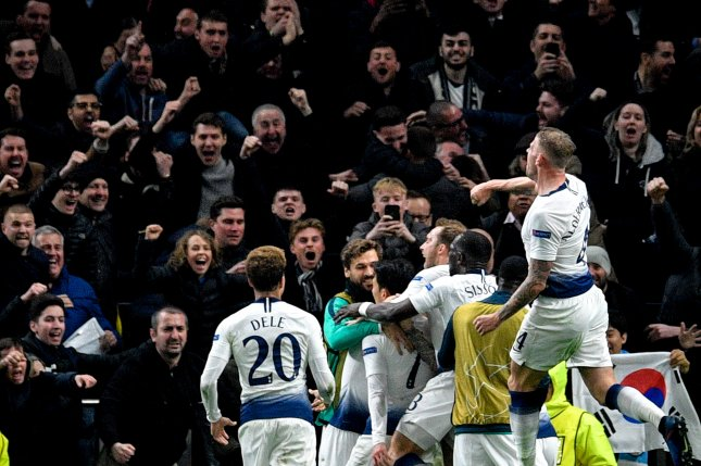 Tottenham's Son Heung-min (7) was mobbed by teammates after scoring the only goal to beat Manchester City in a Champions League quarterfinal matchup Tuesday in London. Photo by Neil Hall/EPA-EFE