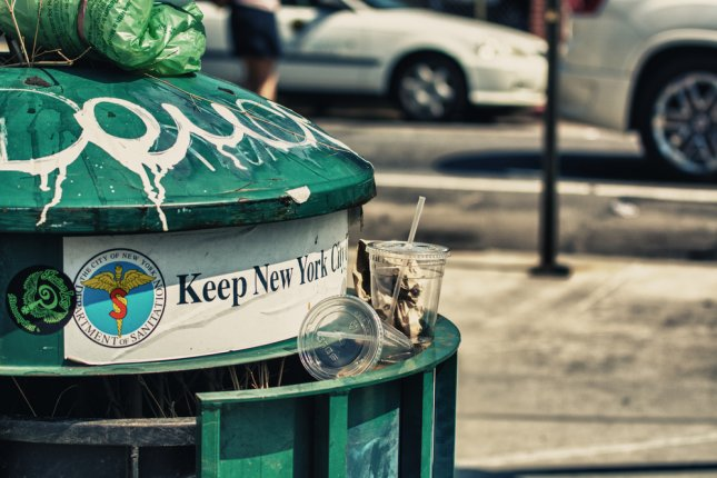 Even when trash cans are overflowing, bugs help keep New York clean. Photo by pisaphotography/Shutterstock