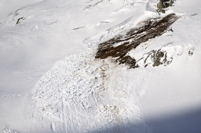Rescue forces and helicopters search for missing people after an avalanche swept down a ski piste in the central town of Andermatt, Switzerland, on Thursday. Photo by Urs Flueeler/EPA-EFE