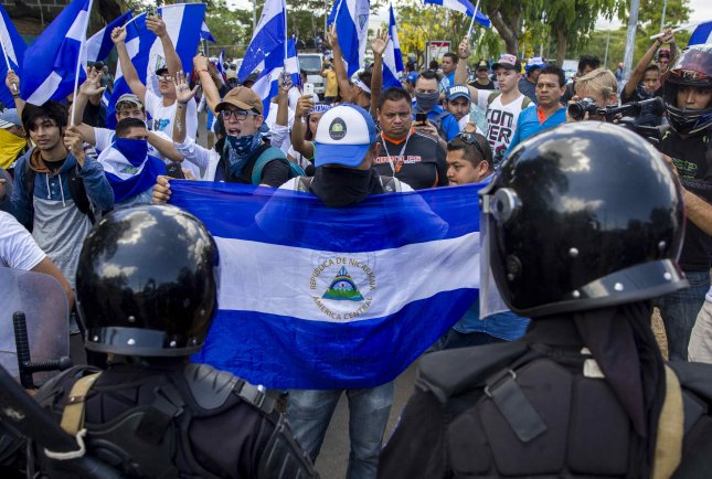 Anti-riot agents prevent the passage of a protest demanding justice for the young people killed in the past demonstrations, in Managua, Nicaragua, May 2, 2018. Photo by Jorge Torres/EPA-EFE