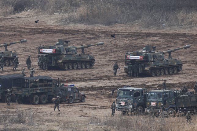 South Korean K-9 self-propelled guns are seen on standby near the western border with North Korea during annual joint military drills with the United States on March 7, 2016. North Korea's Panmunjom mission blamed the drills for tensions on the Korean peninsula on Wednesday. Photo by Yonhap News Agency/UPI