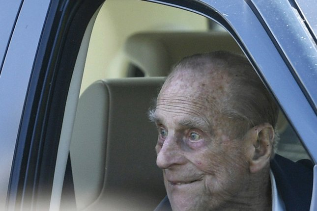 Britain's Prince Philip sits in a car as he watches the Royal Windsor Horse Show on the grounds of Windsor Castle on May 11, 2018. Buckingham Palace announced Saturday that the 97-year-old duke has voluntarily surrendered his driver's license after a crash one month ago. Photo by Neil Hall/EPA