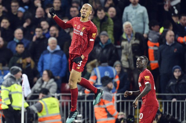 Liverpool's Fabinho (L) scores the first of the Reds' three goals in a win against Manchester City on Sunday at Anfield in Liverpool, England. Photo by Peter Powell/EPA-EFE