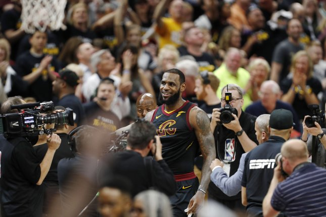 f43ae32b55e Former Cleveland Cavaliers forward LeBron James (C) walks off the court  after the NBA Eastern Conference semifinals basketball Game 3 between the  Toronto ...