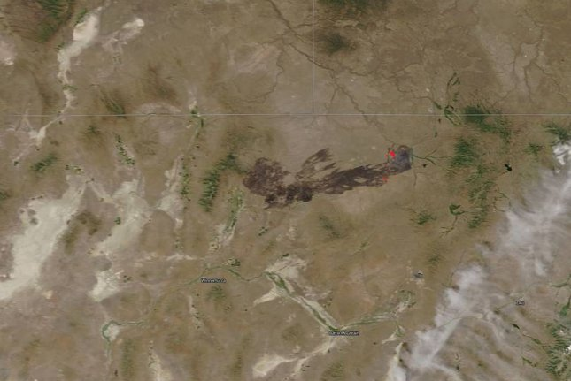 The Martin fire burned a stretch of Nevada's Owyhee Desert, scorching 430,000 acres of sagebrush steppe habitat. The burn scar is visible from space in this natural-color satellite image on July 10, 2018. Actively burning areas, detected by thermal bands, are outlined in red. Image courtesy of NASA