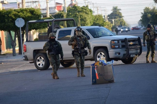 Military personnel from the Mexican Army search sewers at the place where Mexican drug lord Joaquin 'El Chapo' Guzman was recaptured in Los Mochis, Sinaloa, Mexico, 08 January 2016. The Mexican government's crackdown on drug cartels have been blamed for the spike in violence, leading to May being the deadliest month on record in the country. EPA/STR