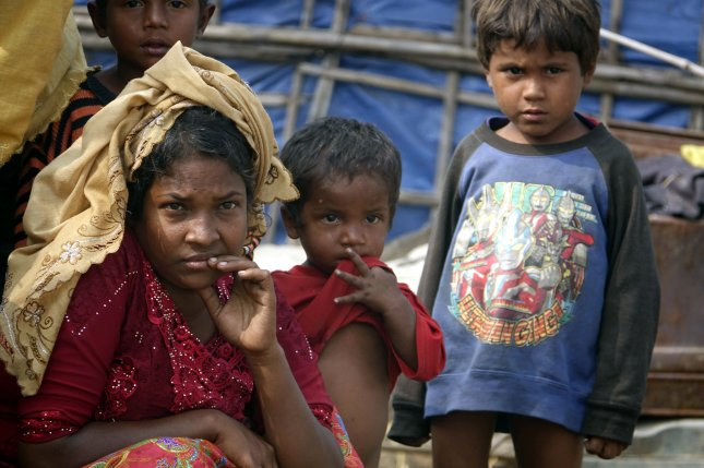 The Rohingya, a stateless Muslim ethnic minority in Myanmar, continue to live in conditions of apartheid and persecution amounting to crimes against humanity, according to a report released by Human Rights Watch on Thursday. File Photo by Nyunt Win/EPA-EFE