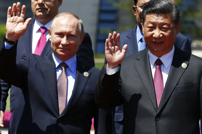 Russia's Vladimir Putin (L) said he supports China's ambitious project of building infrastructure to link three continents. During the Belt and Road Forum, Chinese President Xi Jinping (R) pledged more than $100 billion for development. Photo by Damir Sagolj/EPA