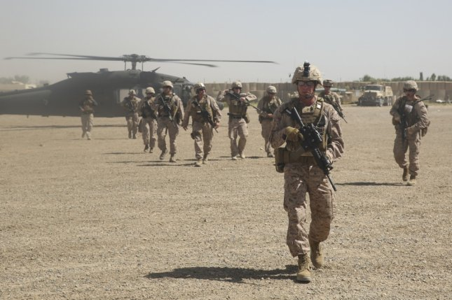 U.S. Marines with Task Force Southwest depart a UH-60 Blackhawk helicopter prior to an advisory meeting with Afghan National Army soldiers at Camp Hanson, Afghanistan, on June 13. File Photo by Sgt. Lucas Hopkins/U.S. Marine Corps/UPI