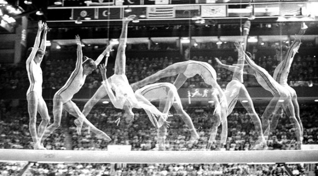 Romania's Nadia Comaneci, 14, won three gold metals and received seven perfect scores at the 1976 Olympics in Montreal. The multiple exposure traces her gold metal balance beam routine. Photo by Darryl Heikes/UPI