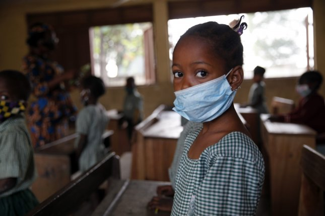 A schoolgirl attends class at the Dairy Farm primary school in Lagos, Nigeria, on January 22. More than 300 schoolgirls were taken from a different school Friday in northern Nigeria. File Photo by Akintunde Akinleye/EPA-EFE
