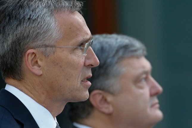 Ukrainian President Petro Poroshenko (R) and Jens Stoltenberg (L), the secretary general of the North Atlantic Treaty Organization, speak to the media Monday after their meeting in Kiev, Ukraine. Photo by Sergey Dolzhenko/EPA