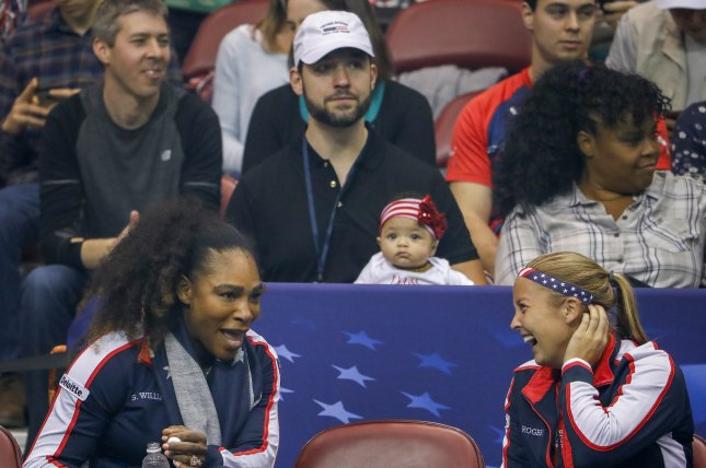 Serena Williams (L) speaks with Shelby Rogers as Williams' husband, Alexis Ohanian (C), holds their daughter Alexis Olympia Ohanian Jr. during a Fed Cup World Group tennis match in Asheville, N.C. Photo by Erik S. Lesser/EPA-EFE