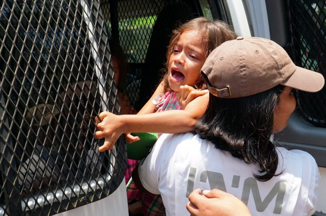 Agents of Mexico's National Institute of Migration of Mexico detain a young girl Monday during an operation in Pijijiapan. Photo by Daniel Ricardez/EPA-EFE