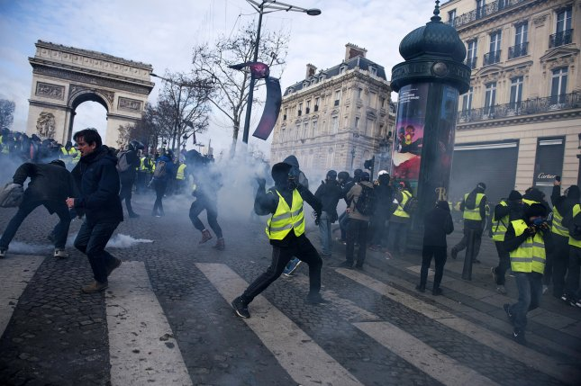 A protester hurls an object at police during a demonstration in Paris, France, on December 8. Photo by Julien de Rosa/EPA-EFE