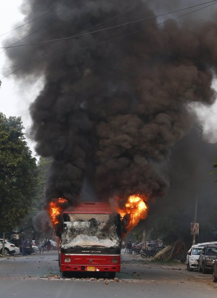 A bus on fire set by demonstrators during a protest against the Citizenship (Amendment) Bill 2019 in New Delhi, India, on Sunday. Photo by EPA-EFE