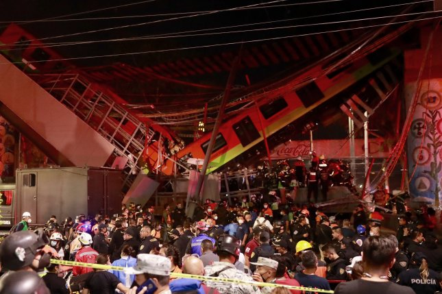 At least 23 people died when an overpass on the elevated track of Line 12 of the Mexico City subway system between Olivos and Tezonco station collapsed Monday night. Photo by Carlos Ramierz/EPA-EFE