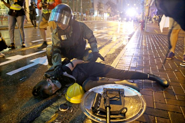 HK police: Protester violence forced use of water cannon, warning shot