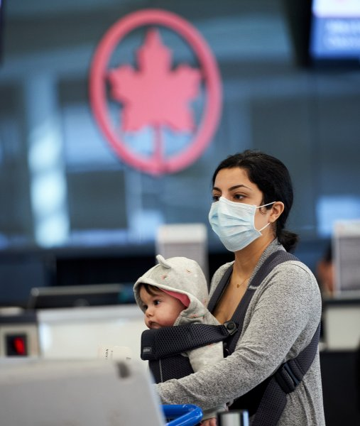 Most foreign nationals still cannot enter Canada by air, land or sea. The border has been closed tonon-essential travel since March 2020. File Photo by Andre Pichette/EPA-EFE