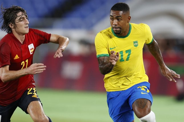 Brazil's Malcom (R) entered the men's soccer gold medal match as an extra-time substitute, but scored the game-winner against Spain at the 2020 Summer Games on Saturday in Yokohama, Japan. Photo by Jeon Heon-Kyun/EPA-EFE