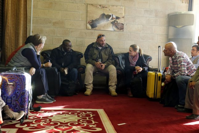 Members of a U.N. truce team tasked with monitoring a cease-fire in the port city of Hudaydah arrive at Sana'a airport on December 22. Photo by Yahya Arhab/EPA-EFE