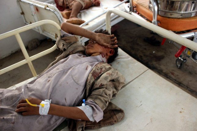 Injured children receive treatment at a hospital after being injured in an alleged Saudi-led airstrike in the northern province of Saada, Yemen, on Thursday. Photo courtesy of EPA-EFE