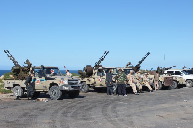 Vehicles and militants gather April 6 to join forces in Tripoli, Libya. Libyan National Army leader Khalifa Haftar ordered his forces to take the capital, which is held by a U.N.-backed unity government. File Photo by EPA-EFE