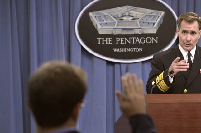 U.S. Navy Rear Adm. John Kirby, the Pentagon press secretary, gives a briefing and answers questions for the media on events within the Department of Defense, the Middle East and Africa during his weekly press conference at the Pentagon in Arlington, Va., Oct. 3, 2014. File photo courtesy the U.S. Department of Defense.