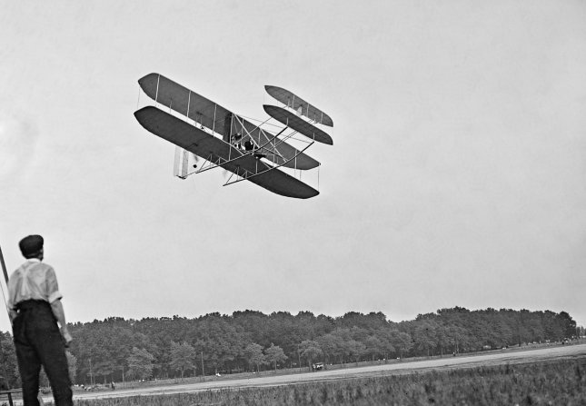 A spectator watches as the demonstrate their new airplane at Fort Myer, Arlington County, Va., on July 8, 1909. Photo by Harris & Ewing/Library of Congress