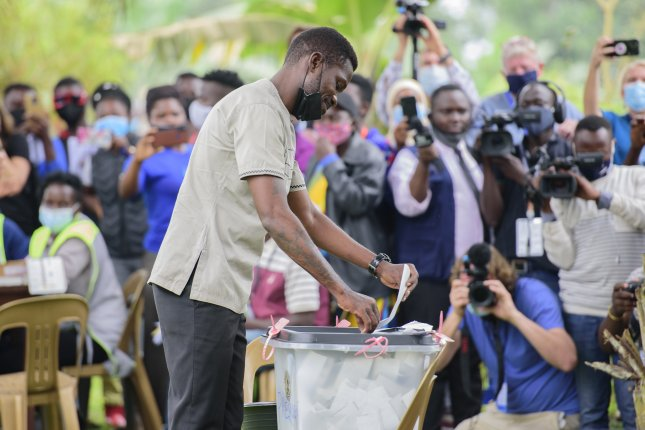 Presidential candidate Robert Kyagulanyi Ssentamu, also known as Bobi Wine, casts his ballot on Thursday during the election in Kampala, Uganda. He is the top challenger vying for the youth vote in his bid to unseat President Yoweri Kaguta Museveni. Photo by EPA-EFE