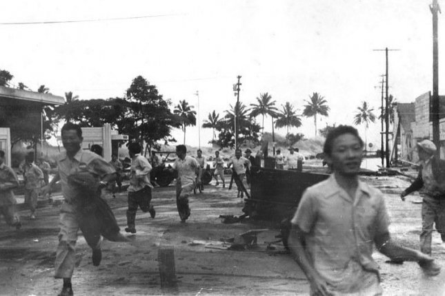People run away from an approaching tsunami in Hilo, Hawaii, on April 1, 1946. The tsunami was sparked by an earthquake in the Aleutian Islands about 4 hours earlier. File Photo courtesy of the Pacific Tsunami Museum/Wikimedia