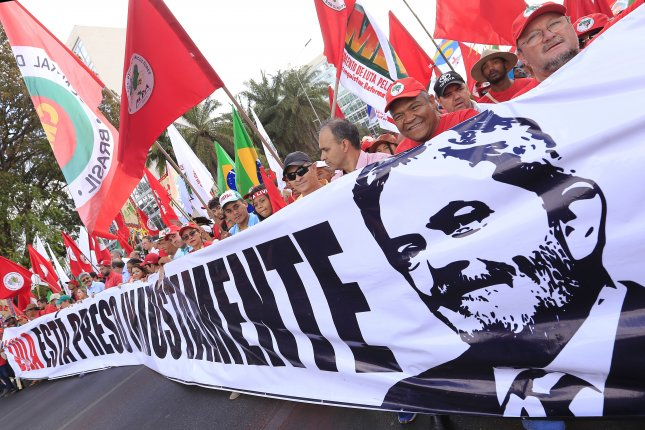 Supporters marched to the Supreme Court of Justice to rally in favor of the registration of the candidacy of former president Luiz Inacio Lula da Silva for Brazil's president on Aug. 15. Since then, Brazil's top electoral court has ruled that Lula cannot run for re-election. File Photo by Joedson Alves/EPA-EFE