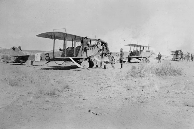 Crews working on the Curtiss JN-3 airplanes of the U.S. Army's First Aero Squadron, which flew from a newly established base at Columbus, N.M., during the 1916-17 U.S. military Punitive Expedition in Mexico that sought to kill or capture Mexican revolutionary Francisco Pancho Villa. File Photo by Library of Congress/UPI