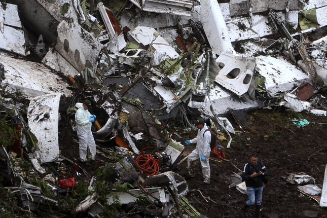 Rescue workers look for bodies after a plane crash in the municipality of La Union, Department of Antioquia, Colombia on November 29, 2016. According to reports, 75 people died when an aircraft crashed late November 28 with 81 people on board, which investigators now blame on human error credited to a flawed flight plan and the plane running out of fuel because of the poor planning of crew and the airline. File photo by Luis Eduardo Noriega A./European Pressphoto Agency